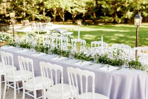 Head table for an outdoor destination wedding in France with wedding planner Muriel Saldalamacchia Photo by Remi Dupac.