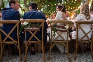 x-chairs wood with bride and groom signs in Les Baux de Provence for a destination wedding planned by Muriel Saldalamacchia Photo by Cecile Creiche